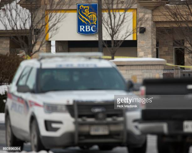 Police vehicles block the entrance into the plaza where the bank is located The suspect in an armed robbery at an RBC branch on Major Mackenzie Drive...