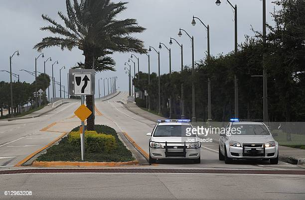 Police vehicles block the entrance to Hutchinson Island as Hurricane Matthew approaches the area on October 6 2016 in Jupiter United States The...
