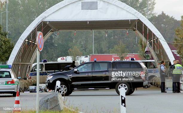 Police vehicles can be seen at a check point near Kiefersfelden Germany 30 September 2016 Last night 'explosivelike substances' were found there in a...