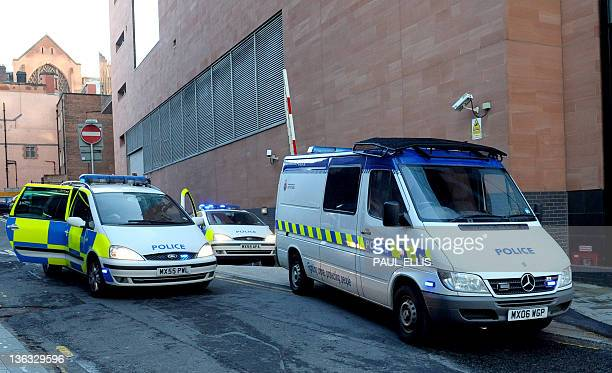 Police vehicles carrying armed police officers form a convoy to transport Kiaran Stapleton who appeared at Magistrates Court in Manchester...