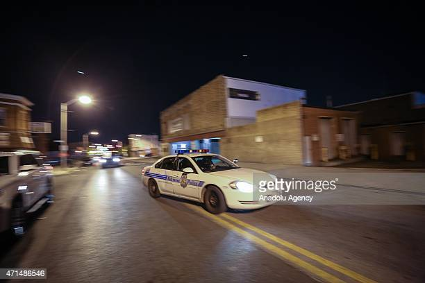 Police vehicles gather during a curfew in Baltimore, Maryland, USA, 28 April 2015. Tensions eased on 28 April after demonstrators kept rock-throwing...