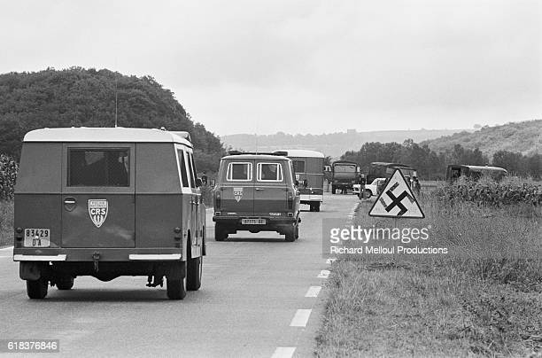 Police vehicles leave the site where 60000 European antinuclear activists protested against the breeder reactor at CreysMalville During the protest a...