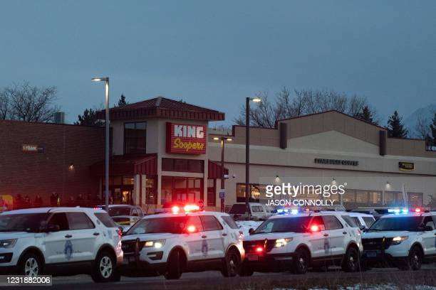 Police vehicles line the outside of the King Soopers grocery store in Boulder, Colorado on March 22, 2021 after reports of an active shooter. - A...
