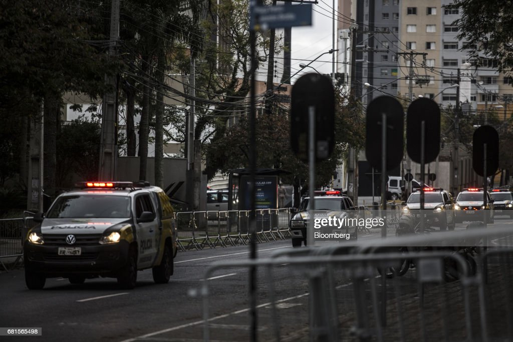 Police vehicles patrol the surrounding area of the federal courthouse where Luiz Inacio Lula da Silva, former president of Brazil, is scheduled to testify before Sergio Moro, the lead jurist in the sprawling corruption probe known as Operation Carwash, in Curitiba, Brazil, on Wednesday, May 10, 2017. Thousands of Brazilians are descending on the southern city of Curitiba before a showdown between one of the most popular leaders in the country's history and its most famous judge at a hearing that could determine the republic's future. Photographer: Dado Galdieri/Bloomberg via Getty Images