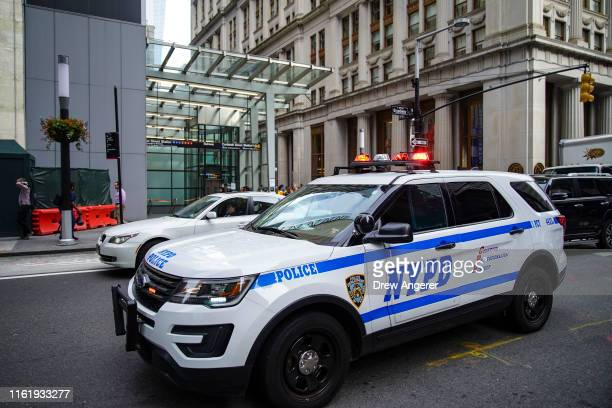 Police vehicles respond near the scene of a suspicious package near the Fulton Street subway station in Lower Manhattan on August 16, 2019 in New...