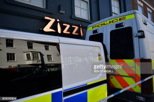 Police vehicles sit on the pavement inside the cordon outside a branch of the Italian chain restaurant Zizzi close to The Maltings shopping centre in...