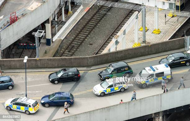 UK Police vehicles surrounding a stopped car