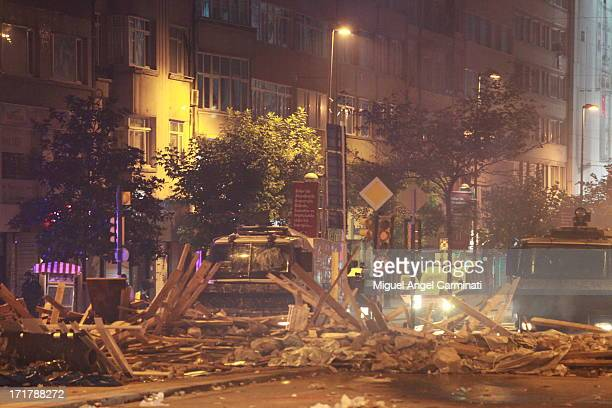 CONTENT] Police vehicles TOMA stopped by barricades in Osmanbey area near Taksim Square during the night riots at Istanbul