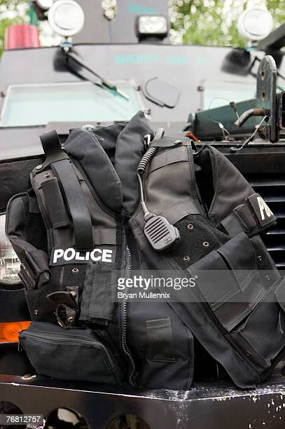 police vest sitting on bumper of armored vehicle - task force stock pictures, royalty-free photos & images
