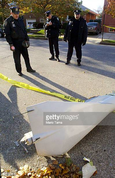 Police view an apparent piece of airplane wreckage near the American Airlines flight 587 crash site November 12 2001 at Rockaway Beach in Queens New...