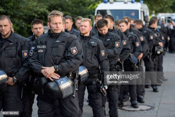 Police wait at Hamburg harbor near the 'Welcome to Hell' antiG20 demonstration on July 6 2017 in Hamburg Germany Leaders of the G20 group of nations...