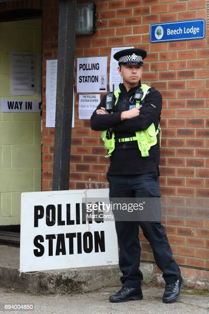 Police wait outside the polling station where Conservative Party leader Theresa May is expected to vote on June 8 2017 in Maidenhead England Polling...