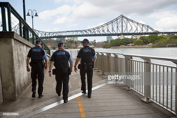 Police walk along the water front ahead of the G20 Leaders Summit on November 12 2014 in Brisbane Australia Police patrol along the Brisbane River...