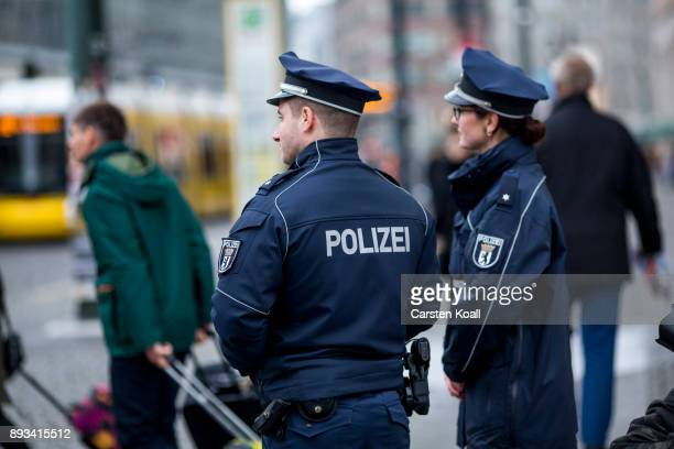 Police walk for the press during a media event at the Alexanderplatz shortly after the inauguration of a new police station at Alexanderplatz on...