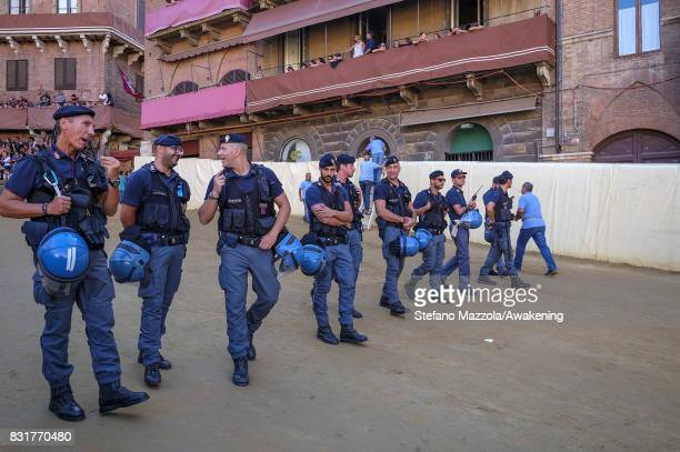 Police walk in Piazza del Campo ahead of tomorrow's Palio on August 15 2017 in Siena Italy The Palio is the most famous event in Siena and is a horse...
