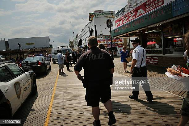 Police walk on the boardwalk in Atlantic City on July 29 2014 in Atlantic City New Jersey Since January of 2014 four of Atlantic City's 11 casinos...