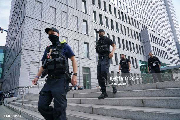 Police walk outside Charite hospital where Russian opposition politician Alexei Navalny is being treated on August 24, 2020 in Berlin, Germany. A...