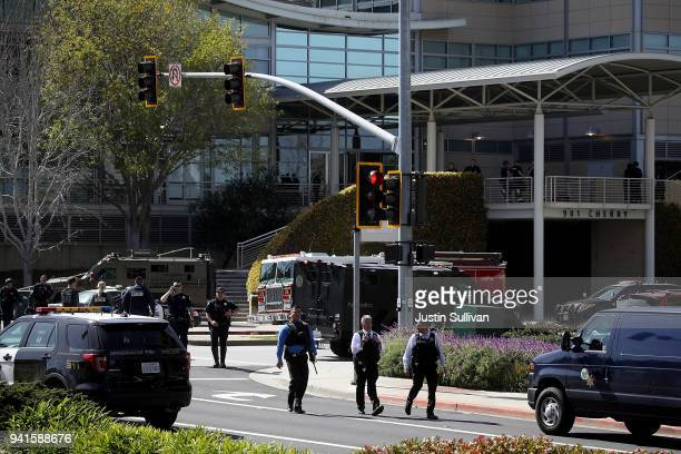 Police walk outside of the YouTube headquarters on April 3 2018 in San Bruno California Police are investigating an active shooter incident at...