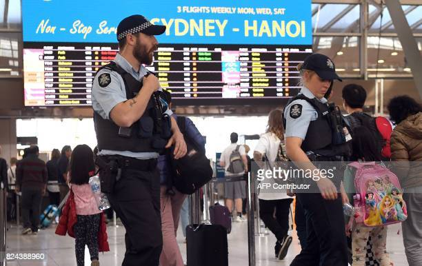 Police walk past passengers as they patrol Sydney Airport on July 30 2017 Australia has foiled an Islamistinspired 'terrorist plot' to bring down an...