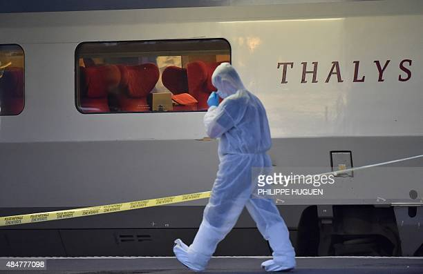 Police walks on a platform next to a Thalys train of French national railway operator SNCF at the main train station in Arras northern France on...