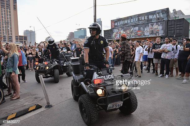 Police watch as Lee Spielman of Trash Talk performs on stage at Beerland as police arrive in order to end the performance on March 14 2014 in Austin...