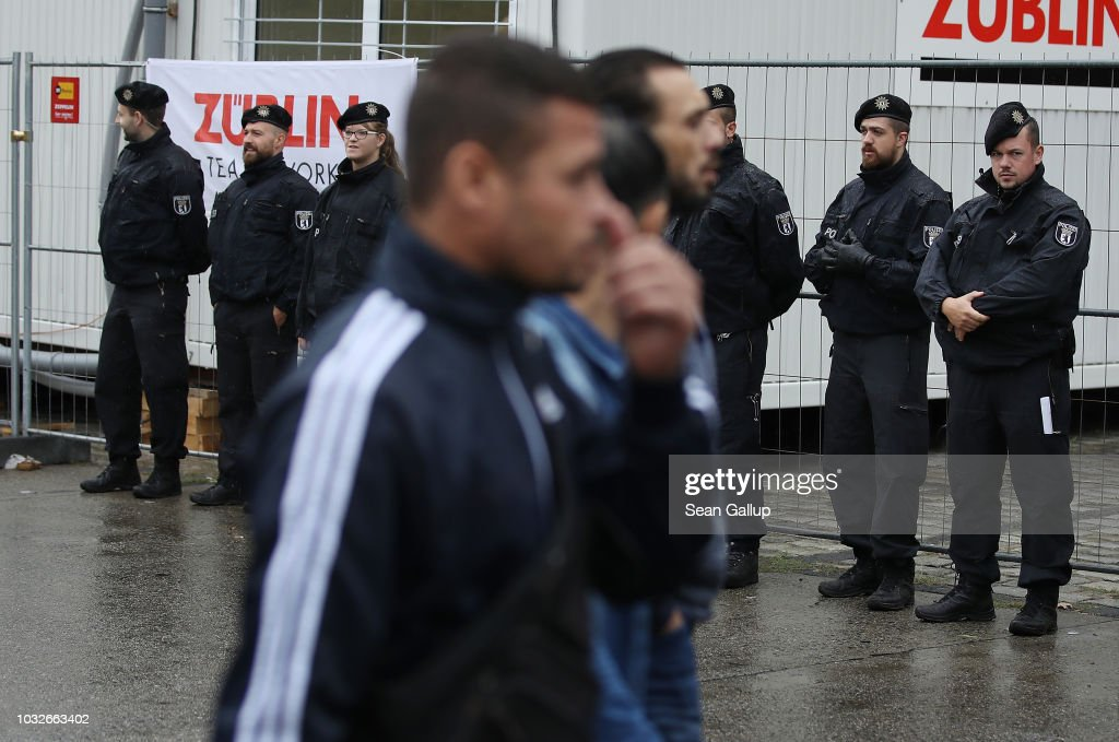 Police watch as mourners arrive for the funeral of Nidal R., an associate of a Berlin Arab clan, outside the New 12 Apostles cemetery on September 13, 2018 in Berlin, Germany. Nidal R., 36, a multiple felon, was gunned down by assailants who managed to flee the scene at a public park last Sunday. Berlin has a growing number of Arab, Kurdish and Turkish clans involved in organized crime.
