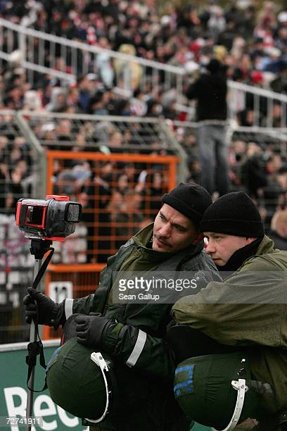 Police watch fans of the FC Union Berlin soccer team taunt fans supporting rivals Dynamo Dresden at the teams' 3rd Liga match November 4 2006 in...