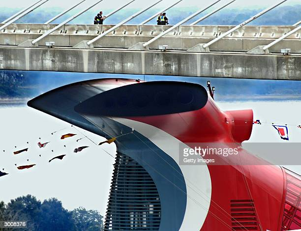 Police watch from the Dames Point Bridge as the funnel of the 2124passenger Carnival Miracle passes just six feet below the 177foothigh span after a...