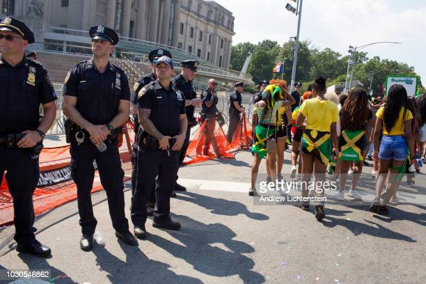 Police watch over the annual West Indian Day Parade on September 3, 2018 in Brooklyn, New York.