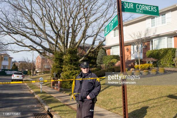 Police watch over the crime scene of the home of alleged Gambino family mafia crime boss Frank Cali on March 14 2019 in the Todt Hill neighborhood of...