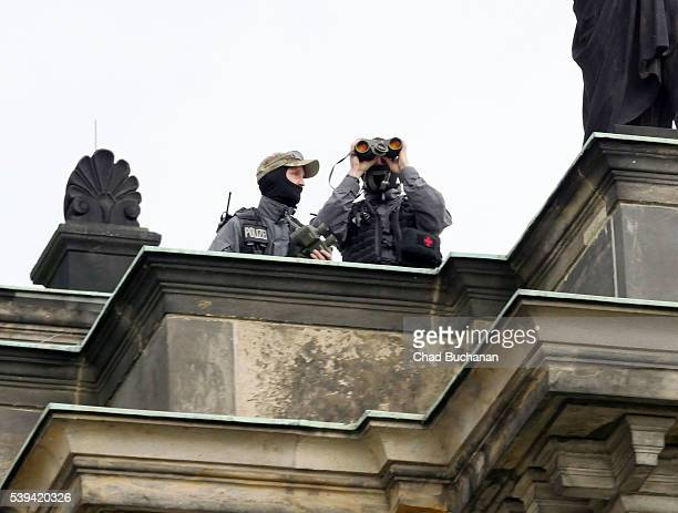 Police watch over the surroundings as participants in the 2016 Bilderberg conference visit the Dresden Opera House or 'Semperoper' during a group...
