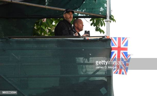 Police watch Royal fans from high vantage points on the Long Walk near the castle before the wedding of Prince Harry to Ms Meghan Markle at St...