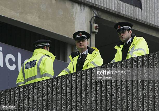 Police watch the area around Terminal 1 of Manchester Airport where passengers were evacuated after an incident between Terminals 1 and 2, on...