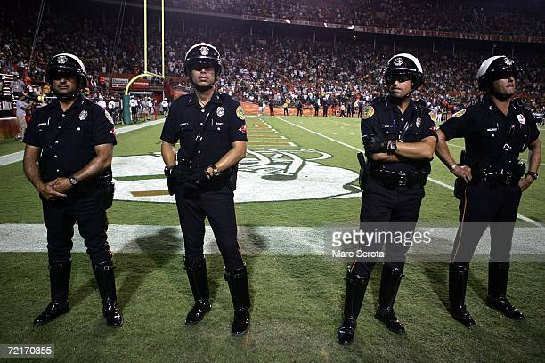 Police watch the field after a brawl broke out between players of the University of Miami Hurricanes and the Florida International University...