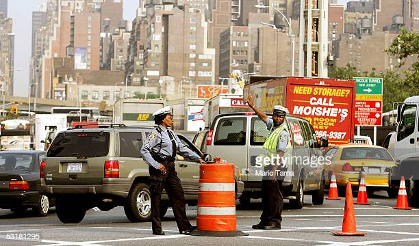 Police watch traffic entering the Lincoln Tunnel at the start of the Fourth of July holiday weekend July 1 2005 in New York City Hundreds of...