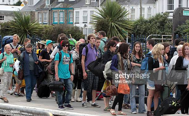 Police watch train passengers walking from the London Paddington train that has just arrived in Newquay on August 6, 2010 in Newquay, England. As...