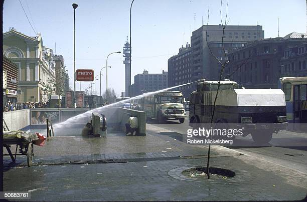 Police water canon in action during AntiPinochet government demonstration