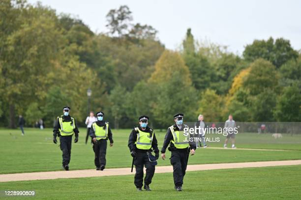 Police wear face masks as they patrol prior to a protest action against restrictions imposed during the novel coronavirus COVID-19 pandemic, in Hyde...