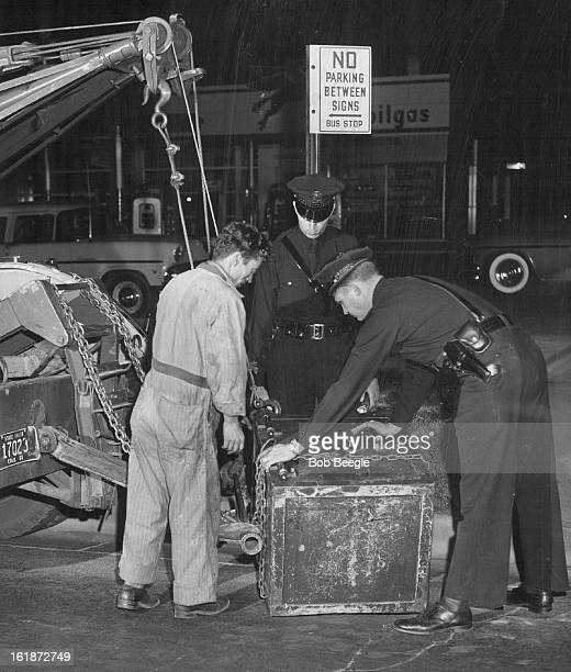 OCT 9 1956 OCT 10 1056 Police with an assist from a garage wreck truck recover a heavy safe belonging to Standard Brands Inc 5135 E 38th Ave from the...