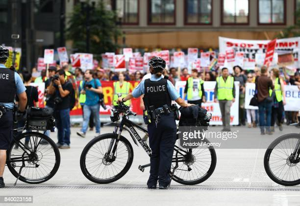 Police with bicycles block a road during a protest against racism and hate in Chicago United States on August 27 2017 People from different...