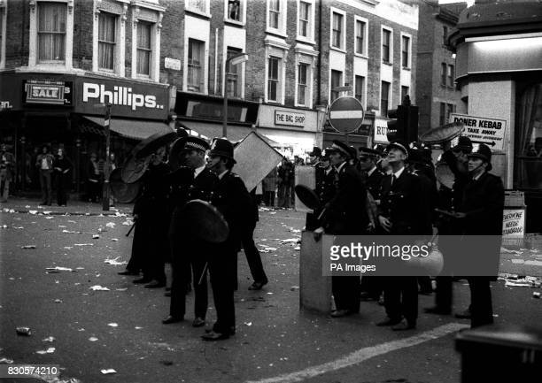 Police with drawn truncheons and using dustbin lids as shields in Notting Hill a West Indian area of London after the calypso carnival became a...