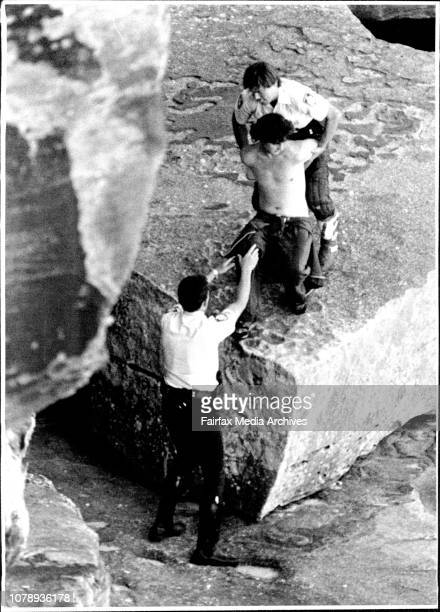 Police with Geoffrey Orme after capturing him at the bottom of the rocks Long Bay Goal escapee Geoffrey James Orme lwho was serving time on a...