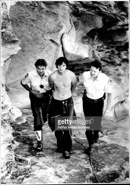 Police with Geoffrey Orme moments after capturing him at the bottom of the rocks Long Bay Goal escapee Geoffrey James Orme who was serving time on a...