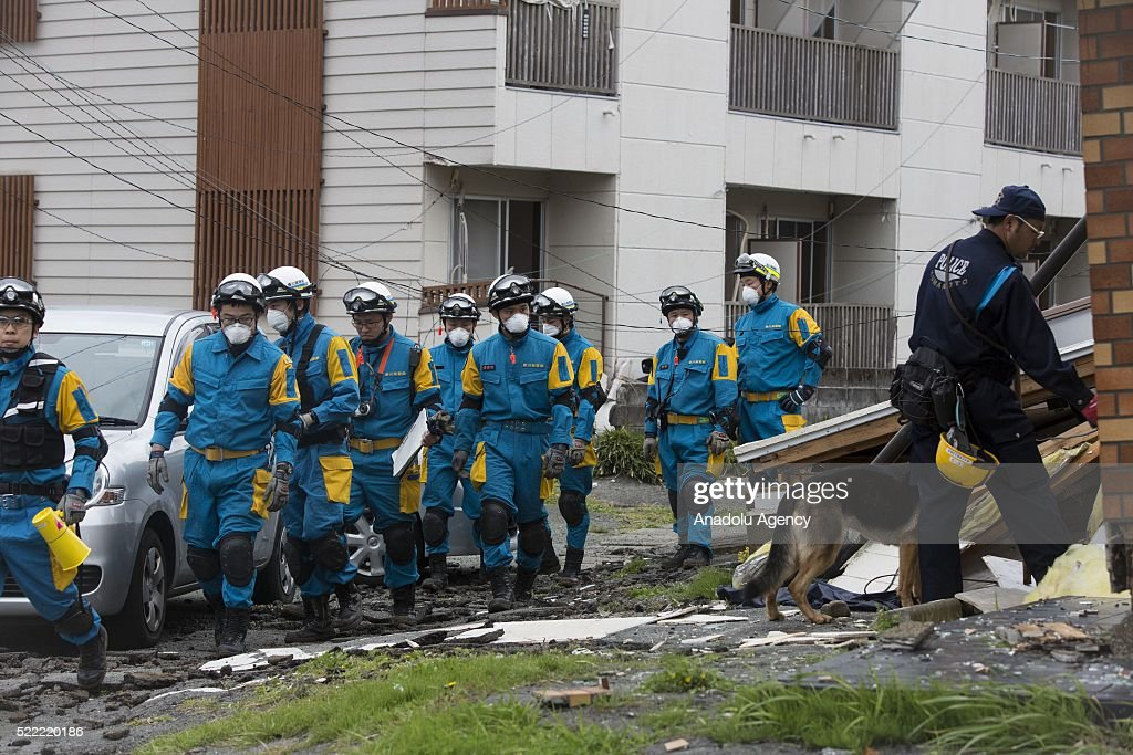 Police with k9 dog continue to search missing bodies on April 18, 2016 in Minamiaso, Kumamoto, Japan. After the magnitude 7.3 earthquake hit Kyushu at least 42 people have died and 11 still missing.