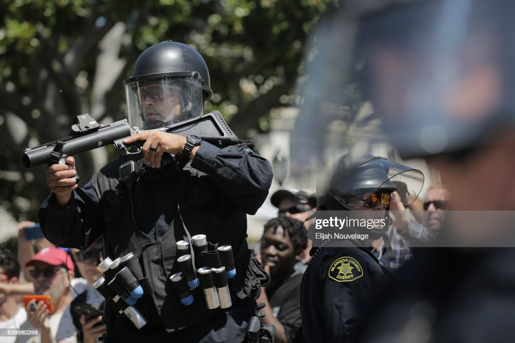 Police with rubber bullet launchers stand guard at MLK Jr. Park on August 27, 2017 in Berkeley, California. The park became a center of left-wing protest when hundreds of people opposed to President Trump and hundreds more aligned with Antifa descended on it after a planned right-wing rally was cancelled.