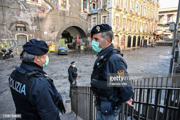 Police with the protective masks control the traditional openair fish market a piscaria closed due to the Coronavirus emergency on March 12 2020 in...