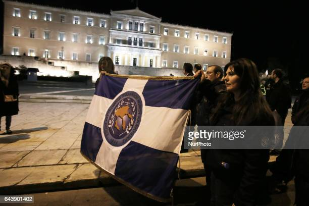 A police woman demonstrates in front of the Greek parliament during an antiausterity rally in central Athens Greece on February 22 2017 Police...