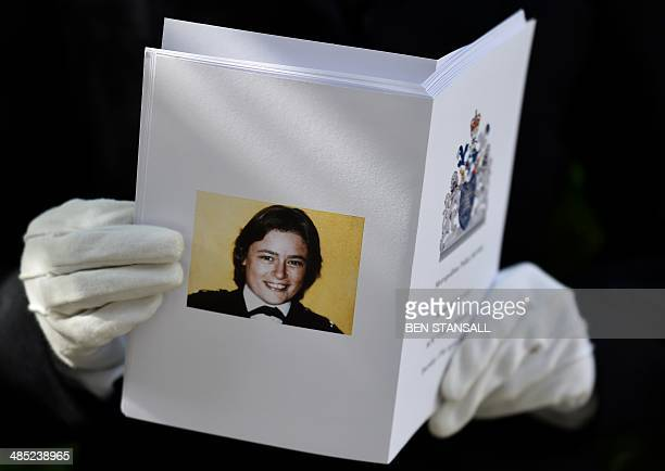 A police woman holds an order of service ahead of a remembrance service to mark the 30th anniversary of the killing of British police officer Yvonne...