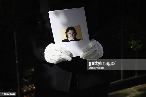 Police woman holds an order of service during a memorial service for the murdered Police woman Yvonne Fletcher in St James' Square on April 17 2014...