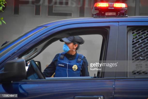 Police woman is seen with a mouth cover during phase two of contingency measures to avoid the spread of COVID-19 on March 25, 2020 in Mexico City,...